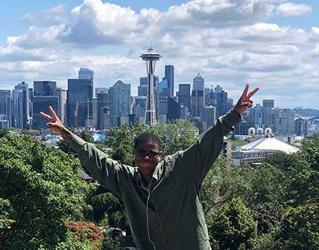 Dashon Murray poses for a photo in front of the space needle in Seattle.