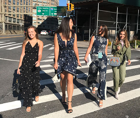 Victoria Randall, Meg Schweiterman and one other student cross at Manhattan street near NYFW: The Shows