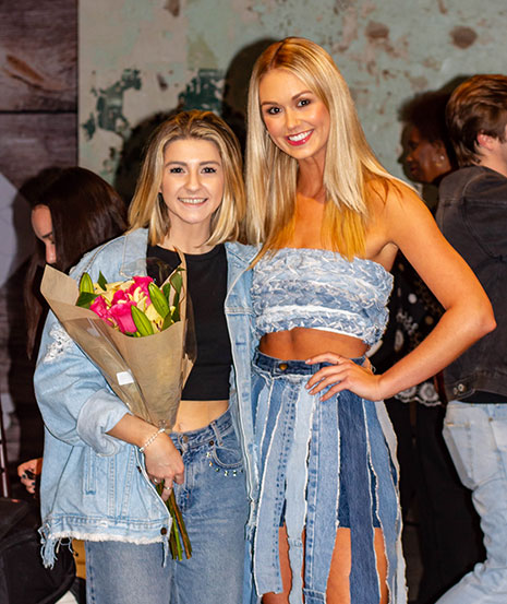 Sarah-Jane Long poses with model Katie Turner as they are announced winners at the Student Designer Showcase during UofSC Fashion Week's Fashion Show