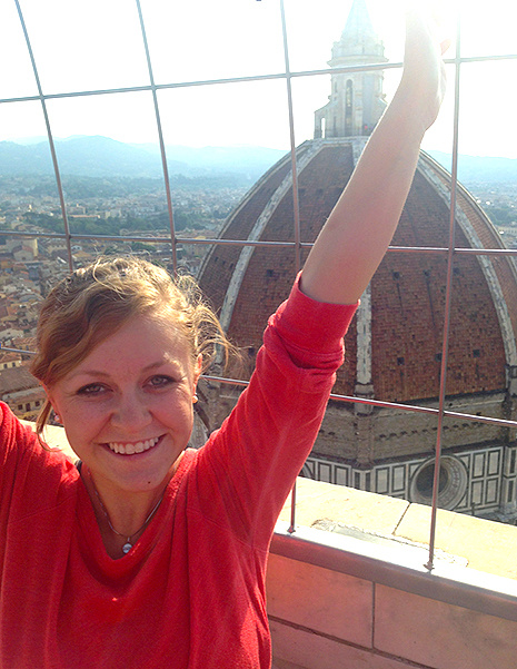 Annie Grove poses overlooking Santa Maria del Fiore, or Saint Mary of the Flowers, in Florence, Italy