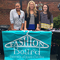 Fashion Board students stand with their booth on Green Street near the Russell House during a UofSC student organization and clubs fair.