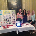 HRTM planners stand at their table of information during HRSM student welcome