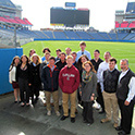 A group of Sigma Psi Mu students getting a tour of a sport and entertainment venue.