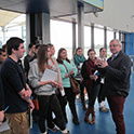 A group of Sport and Entertainment Management graduate students get a tour of a large sport and entertainment venue.