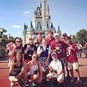 Theme Parks and Attractions Club members at the Magic Kingdom castle on a visit to Disney.