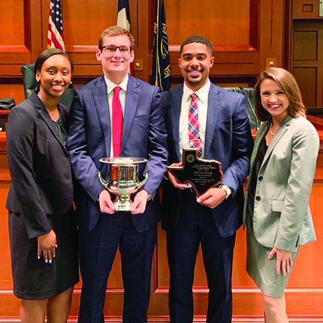 Students Ariyana Gore, Jake Lampke, Austin Nichols and Peri Imler hold the trophies they won during the 2019 Lone Star Classic Mock National Trial Competition.