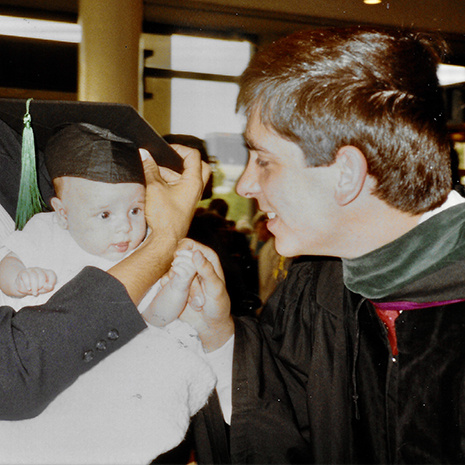 Steve Corso at graduation with infant son Michael