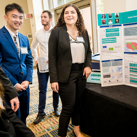 Photo of Katherine DeWeese presenting her Siemens project poster at the fall 2019 Industry Summit