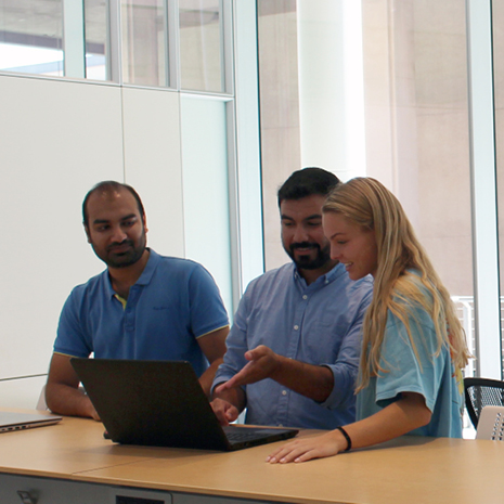 group of students sitting at a table in the data lab
