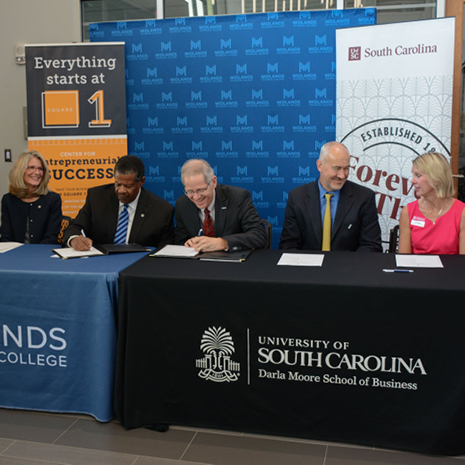 Moore School and Midlands Technical College administrators sign the operations and supply chain transfer pathway agreement at a Sept. 9 press conference