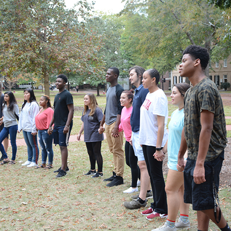 Group of Rising Scholars participating in an exercise on the Horseshoe