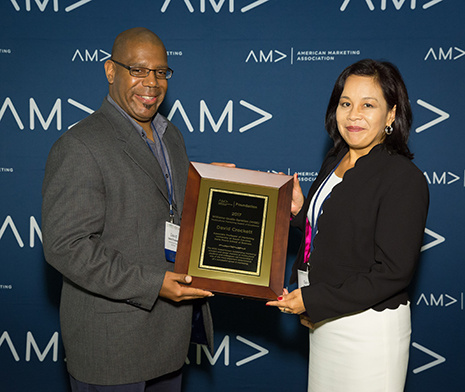 David Crockett receiving the WQS Multicultural Mentoring Award of Excellence
