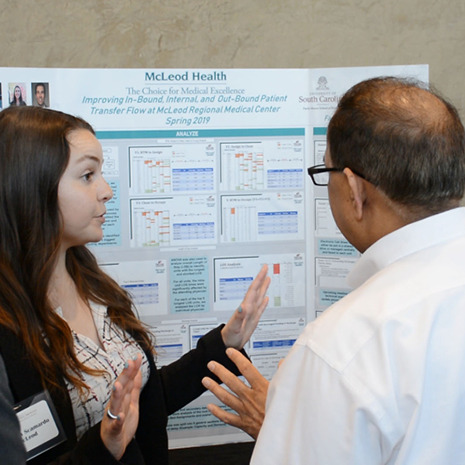 A student presents her McLeod Health project at the Industry Summit