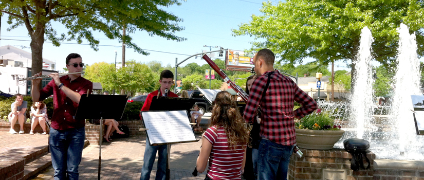 Musicians play in the rose garden during Sounds Around Town event.