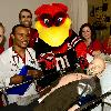 Several nursing students pose with Cocky and a simulator.