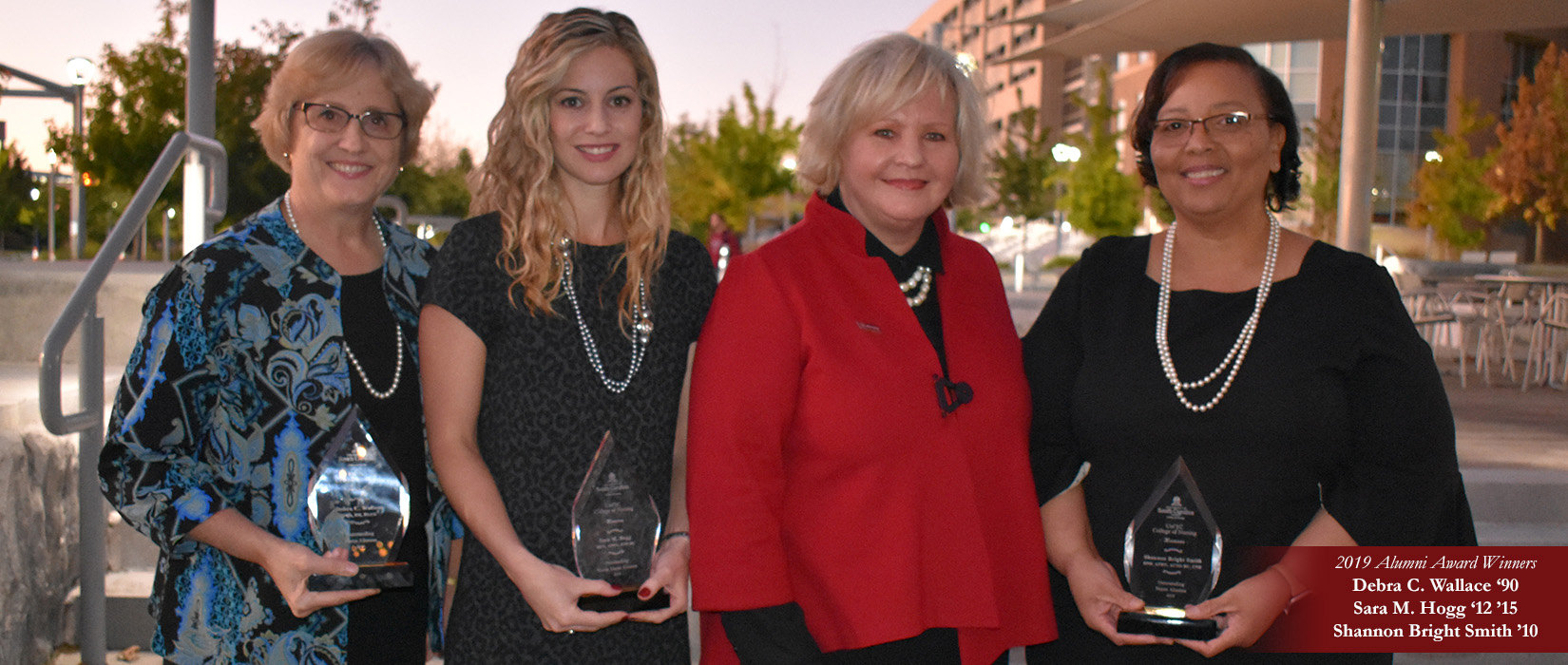 2019 Alumni Award Recipients Debra Wallace, Sara Hogg and Shannon Bright Smith with Dean Jeannette Andrews.