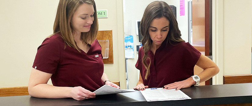 Female pharmacist writing