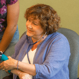 Woman taking a patients blood pressure