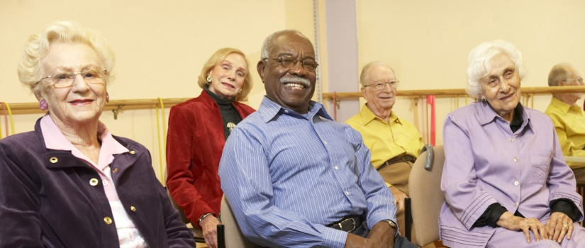 Group of elderly individuals sitting and posing