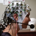 Image of woman in EEG cap on head