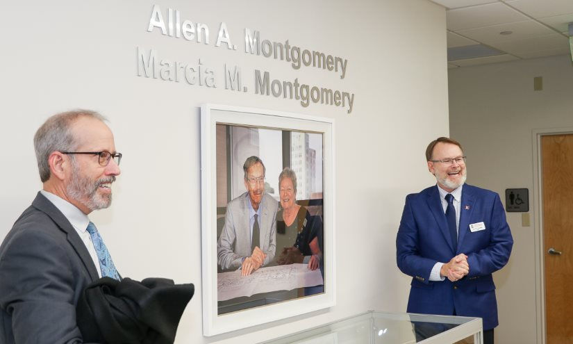 Kenn Apel (left) and Dean Thomas Chandler reveal the portrait of Al and Marcia Montgomery