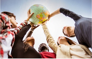 Group of people holding up a globe