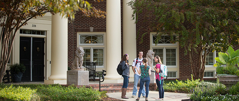 Students congregate outside of academic building