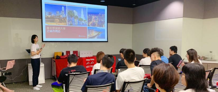 Chinese student gives presentation to classroom of students