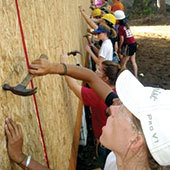 Students building a wall