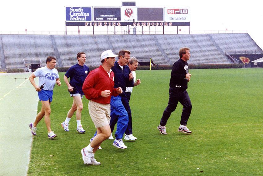 South Carolina Governor Carroll Campbell and President George H.W. Bush running in Williams-Brice stadium.