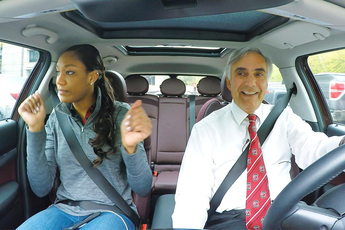 Harris Pastides driving with Aja Wilson in the Mini Cooper