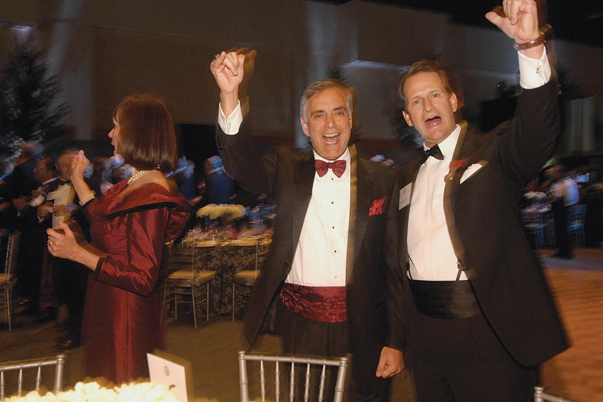 Harris Pastides and David Seaton celebrating at the Carolina's Promise gala