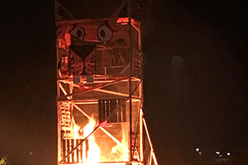 Giant student-made tiger on fire for the annual tiger burn.