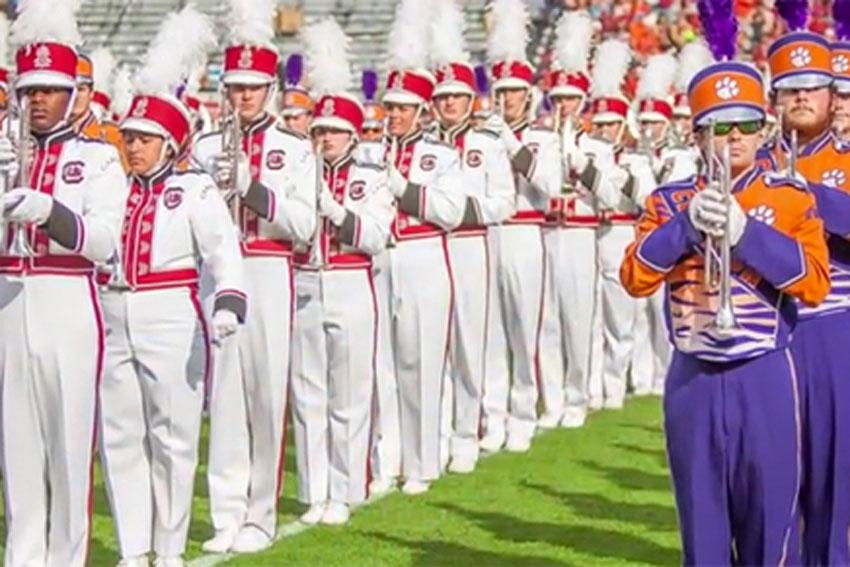 Image of the USC and Clemson marching band playing on the field.