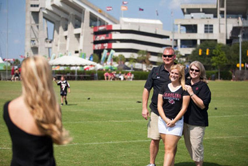 A family taking a photo outside of Williams Brice Stadium.