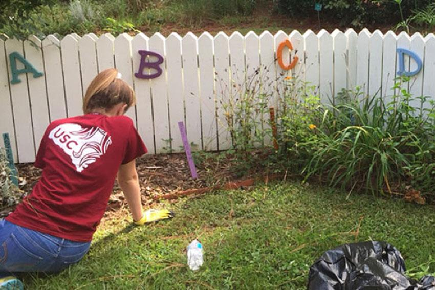 Student volunteering for Service Saturday.