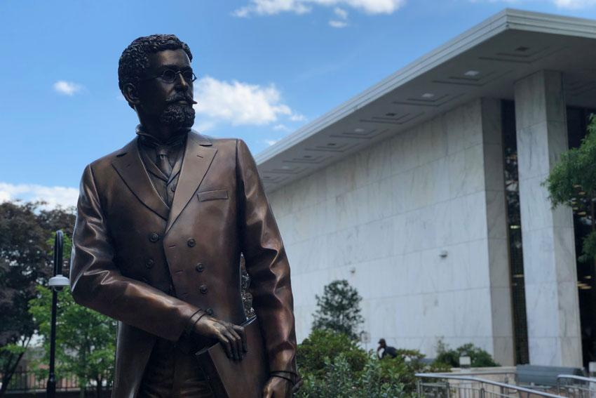 "The ""Richard T. Greener Memorial"" by Jon Hair was installed next to the Thomas Cooper Library Feb. 12, 2018. The statue honors Greener, who  was the first African American professor at UofSC. Photo by One Columbia."