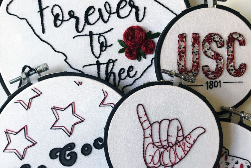 embroidery hoops with Gamecocks slogans including Forever to Thee, Go Cocks and USC 1801