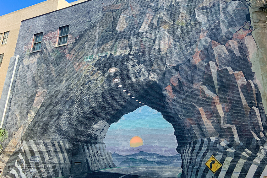 Mural depicting a sunset through a tunnel, called Tunnel Vision.