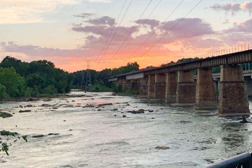 Railroad bridge over the Congaree River at sunset.