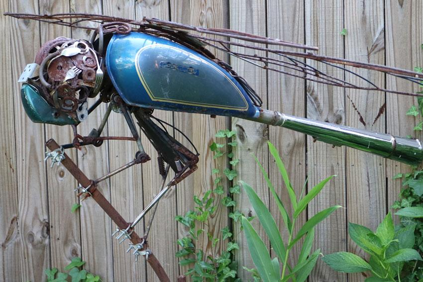 Metal dragonfly sculpture