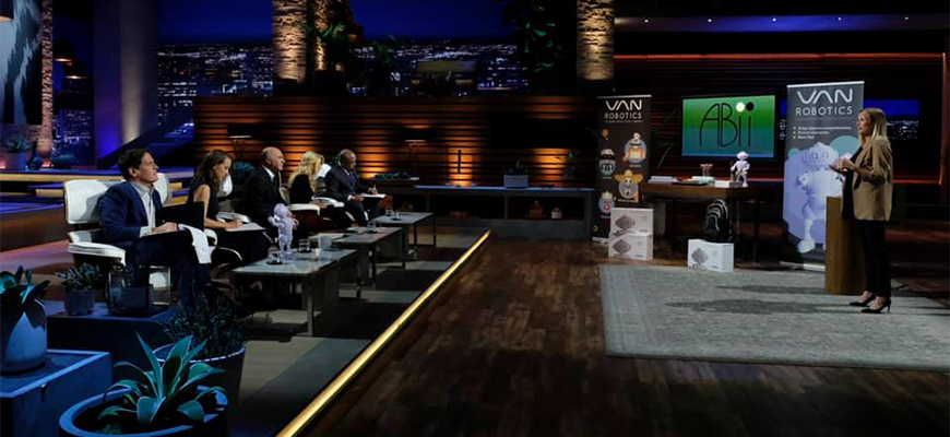 "Laura Boccanfuso stands before the judges on NBC's ""Shark Tank"" to pitch her company's ABii robot tutor."