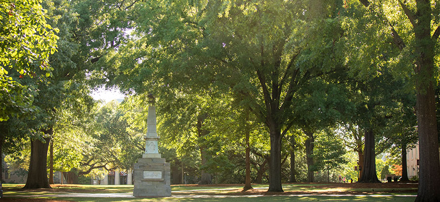 the maxcy monument surrounded by green trees on the UofSC horseshoe