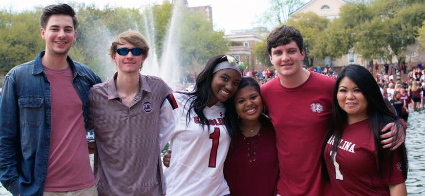 Amelia Wilks and friends celebrate at the fountain at Thomas Cooper Library