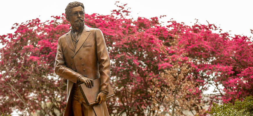 Image of Richard T. Greener statue on campus