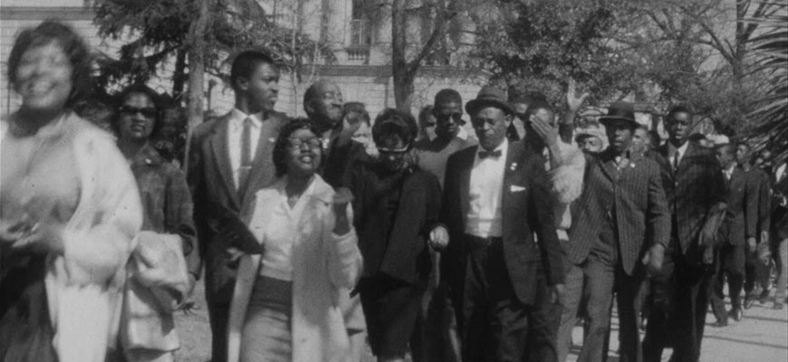 black and white photo of students marching at SC State House in 1961