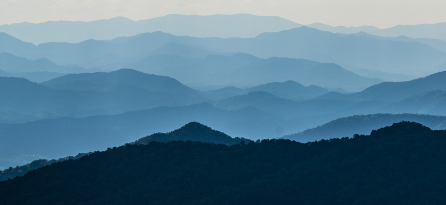 Blue-tinted mountain ranges extending into the distance.