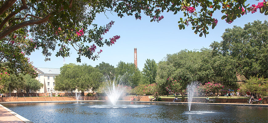 Fountain in front of Thomas Cooper Library with USC smokestack in the background.