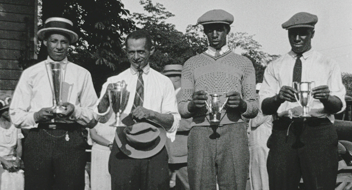 Shippen and fellow golfers with trophies