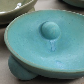 a turquoise bowl by Virginia Scotchie